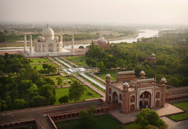 Taj Mahal as the day's first tourists trickle through the gates.