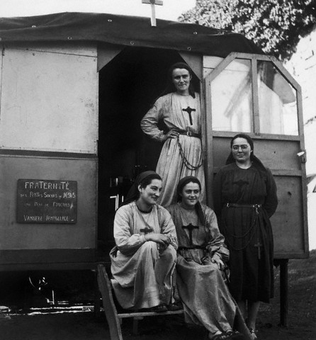 May 1960, France --- Nuns in a gypsy camp in the Rhone Valley. --- Image by © Archives Barrat-Bartoll/Corbis