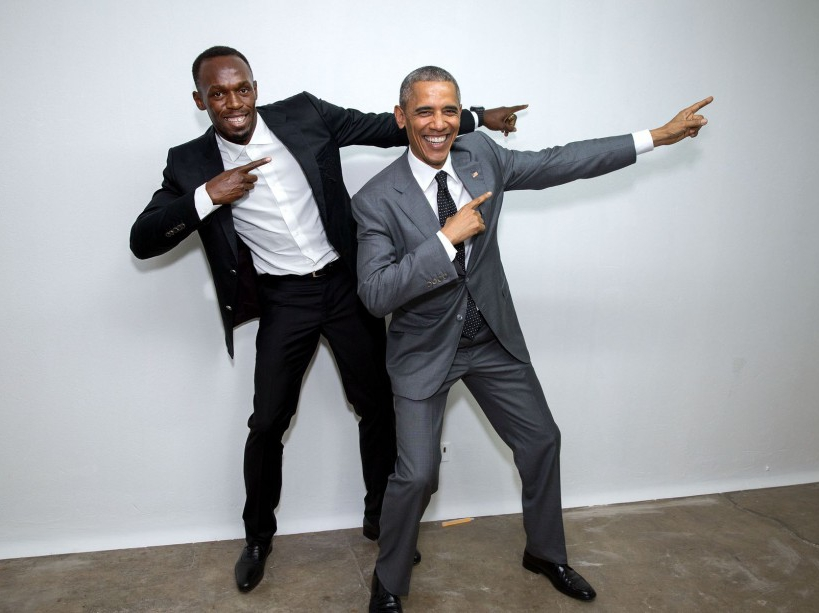 Backstage, the President mimics the victory pose with Usain Bolt, the fastest runner in the world. Bolt, the Jamaican sprinter, attended the town hall. (Official White House Photo by Pete Souza)