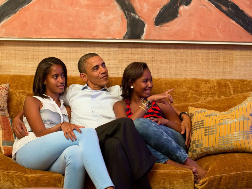 President Barack Obama and his daughters, Malia, left, and Sasha, watch on television as First Lady Michelle Obama takes the stage to deliver her speech at the Democratic National Convention, in the Treaty Room of the White House, Tuesday night, Sept. 4, 2012. (Official White House Photo by Pete Souza)