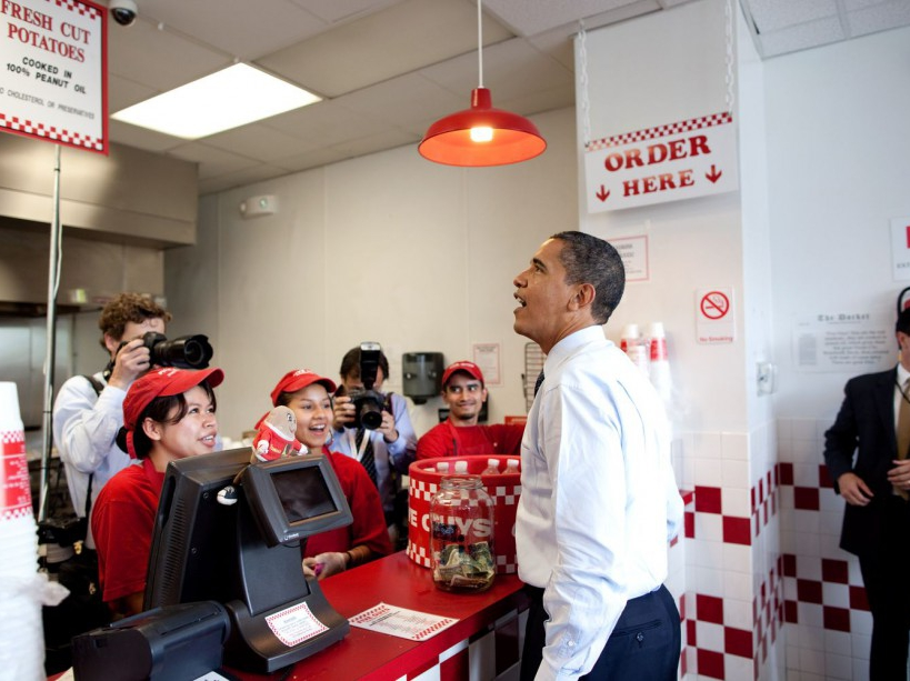 President Obama orders lunch at Five Guys in Washington, D.C. during an unannounced lunch outing May 29, 2009. (Official White House Photo by Pete Souza) This official White House photograph is being made available for publication by news organizations and/or for personal use printing by the subject(s) of the photograph. The photograph may not be manipulated in any way or used in materials, advertisements, products, or promotions that in any way suggest approval or endorsement of the President, the First Family, or the White House.