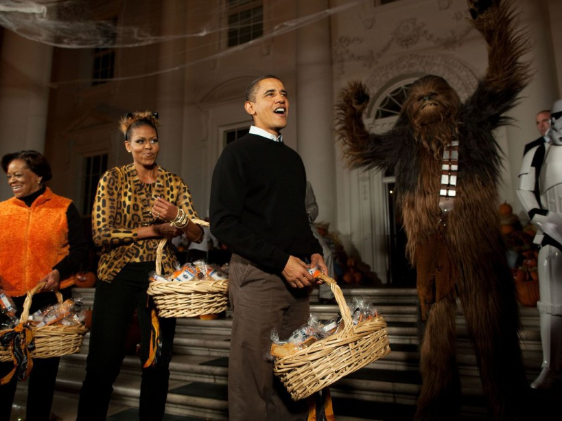 President Barack Obama, First Lady Michelle Obama and Marian Robinson welcome children from Washington, D.C., Maryland and Virginia schools for Halloween festivities at the North Portico of the White House, Oct. 31, 2009. (Official White House Photo by Pete Souza) This official White House photograph is being made available only for publication by news organizations and/or for personal use printing by the subject(s) of the photograph. The photograph may not be manipulated in any way and may not be used in commercial or political materials, advertisements, emails, products, promotions that in any way suggests approval or endorsement of the President, the First Family, or the White House.