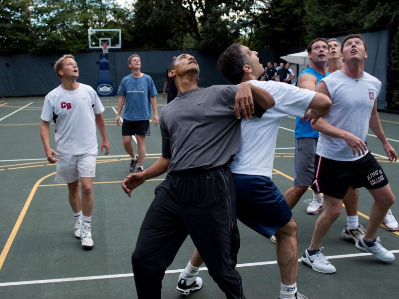 President Barack Obama, along with Cabinet Secretaries and Members of Congress, watch a shot during a basketball game on the White House court, Oct. 8, 2009. (Official White House Photo by Pete Souza) This official White House photograph is being made available only for publication by news organizations and/or for personal use printing by the subject(s) of the photograph. The photograph may not be manipulated in any way and may not be used in commercial or political materials, advertisements, emails, products, promotions that in any way suggests approval or endorsement of the President, the First Family, or the White House.
