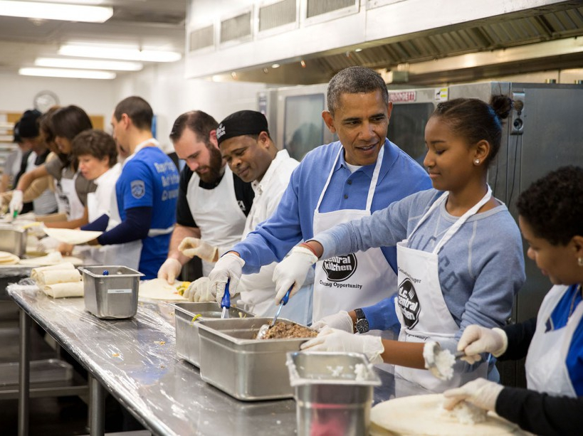 President Barack Obama and his daughter Sasha assemble burritos during a Martin Luther King, Jr. Day of Service event at DC Central Kitchen in Washington, D.C., Jan. 20, 2014. (Official White House Photo by Pete Souza) This official White House photograph is being made available only for publication by news organizations and/or for personal use printing by the subject(s) of the photograph. The photograph may not be manipulated in any way and may not be used in commercial or political materials, advertisements, emails, products, promotions that in any way suggests approval or endorsement of the President, the First Family, or the White House.