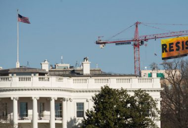 "Greenpeace activists deploy a banner on a construction crane near the White House reading ""RESIST"" on President Trump's fifth day in office.The activists are calling for those who want to resist Trump's attacks on environmental, social, economic and educational justice to contribute to a better America."