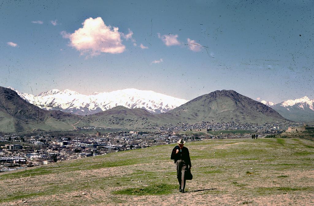 """Dr. Bill Podlich on a hillside in Kabul. """