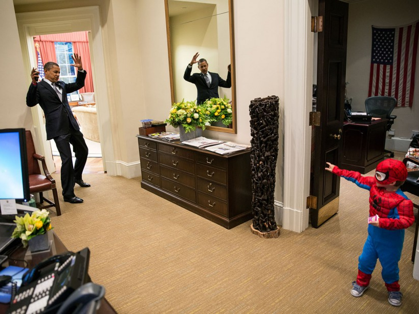 """Oct. 26, 2012 """"The President to be caught in Spider-Man's web as he greets the Nicholas Tamarin, 3, just outside the Oval Office. Spider-Man had been trick-or-treating for an early Halloween with his father, White House aide Nate Tamarin in the Eisenhower Executive Office Building. I can never commit to calling any picture my favorite, but the President told me that this was HIS favorite picture of the year when he saw it hanging in the West Wing a couple of weeks later."""" (Official White House Photo by Pete Souza) This official White House photograph is being made available only for publication by news organizations and/or for personal use printing by the subject(s) of the photograph. The photograph may not be manipulated in any way and may not be used in commercial or political materials, advertisements, emails, products, promotions that in any way suggests approval or endorsement of the President, the First Family, or the White House."""