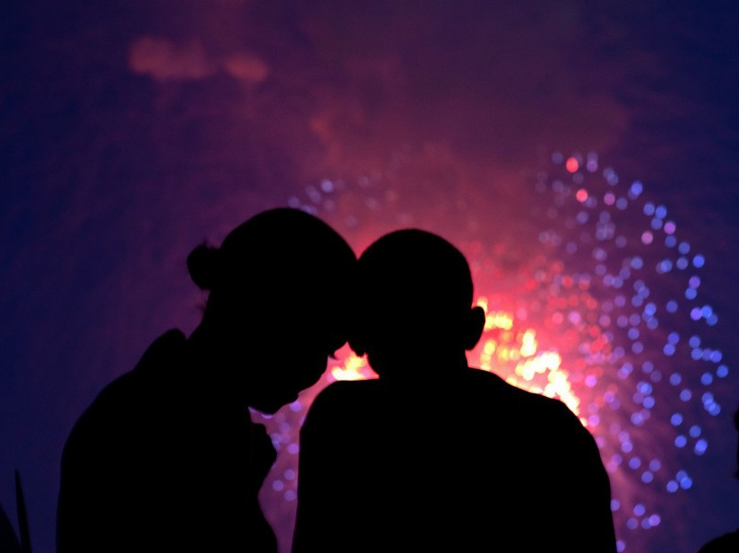 President Barack Obama and First Lady Michelle Obama watch the fireworks over the National Mall from the roof of the White House, July 4, 2010. (Official White House Photo by Pete Souza) This official White House photograph is being made available only for publication by news organizations and/or for personal use printing by the subject(s) of the photograph. The photograph may not be manipulated in any way and may not be used in commercial or political materials, advertisements, emails, products, promotions that in any way suggests approval or endorsement of the President, the First Family, or the White House.