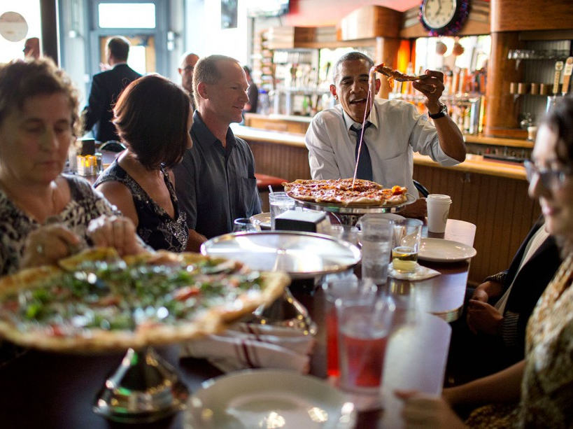 President Barack Obama shares a pizza dinner with individuals who wrote letters to him, at the Wazee Supper Club in Denver, Colo., July 8, 2014. (Official White House Photo by Pete Souza) This official White House photograph is being made available only for publication by news organizations and/or for personal use printing by the subject(s) of the photograph. The photograph may not be manipulated in any way and may not be used in commercial or political materials, advertisements, emails, products, promotions that in any way suggests approval or endorsement of the President, the First Family, or the White House.