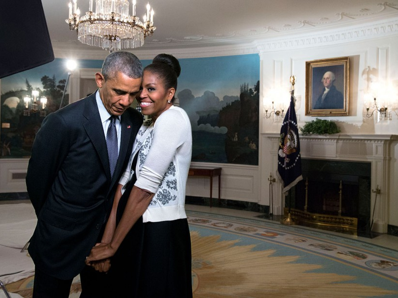 First Lady Michelle Obama snuggles against President Barack Obama before a videotaping for the 2015 World Expo, in the Diplomatic Reception Room of the White House, March 27, 2015. (Official White House Photo by Amanda Lucidon) This official White House photograph is being made available only for publication by news organizations and/or for personal use printing by the subject(s) of the photograph. The photograph may not be manipulated in any way and may not be used in commercial or political materials, advertisements, emails, products, promotions that in any way suggests approval or endorsement of the President, the First Family, or the White House.