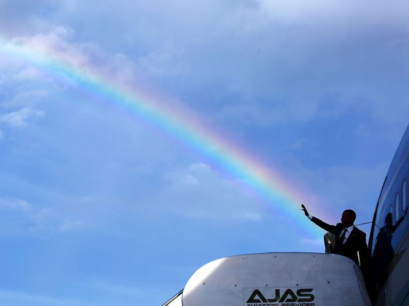 """April 9, 2015 """"The President's wave aligns with a rainbow as he boards Air Force One at Norman Manley International Airport prior to departure from Kingston, Jamaica. Read my Behind The Lens account of this photograph: http://bit.ly/1NMjCjHtk ."""" (Official White House Photo by Pete Souza) This official White House photograph is being made available only for publication by news organizations and/or for personal use printing by the subject(s) of the photograph. The photograph may not be manipulated in any way and may not be used in commercial or political materials, advertisements, emails, products, promotions that in any way suggests approval or endorsement of the President, the First Family, or the White House."""